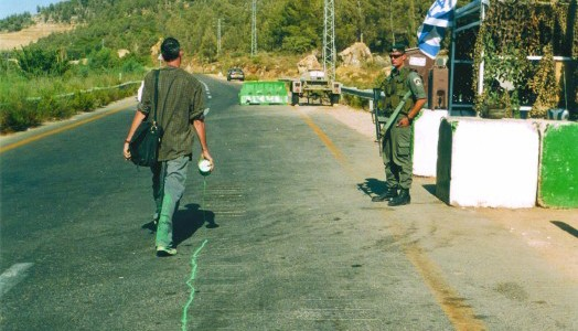 Francis Alÿs, The Green Line, 2005 performance along border in Jerusalem.